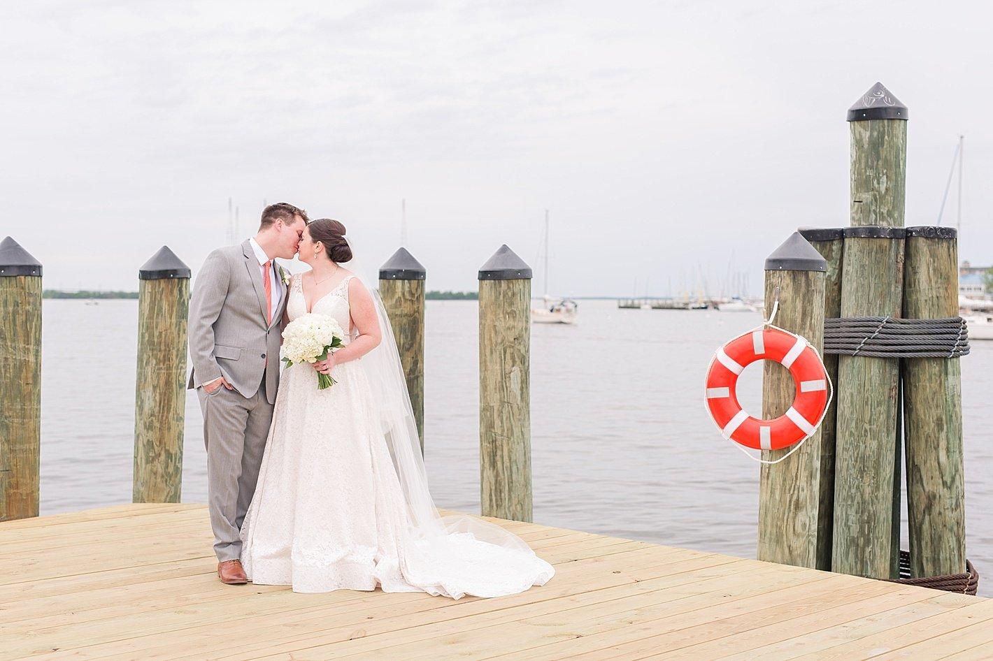 bride and groom bridal portraits Annapolis docks kiss