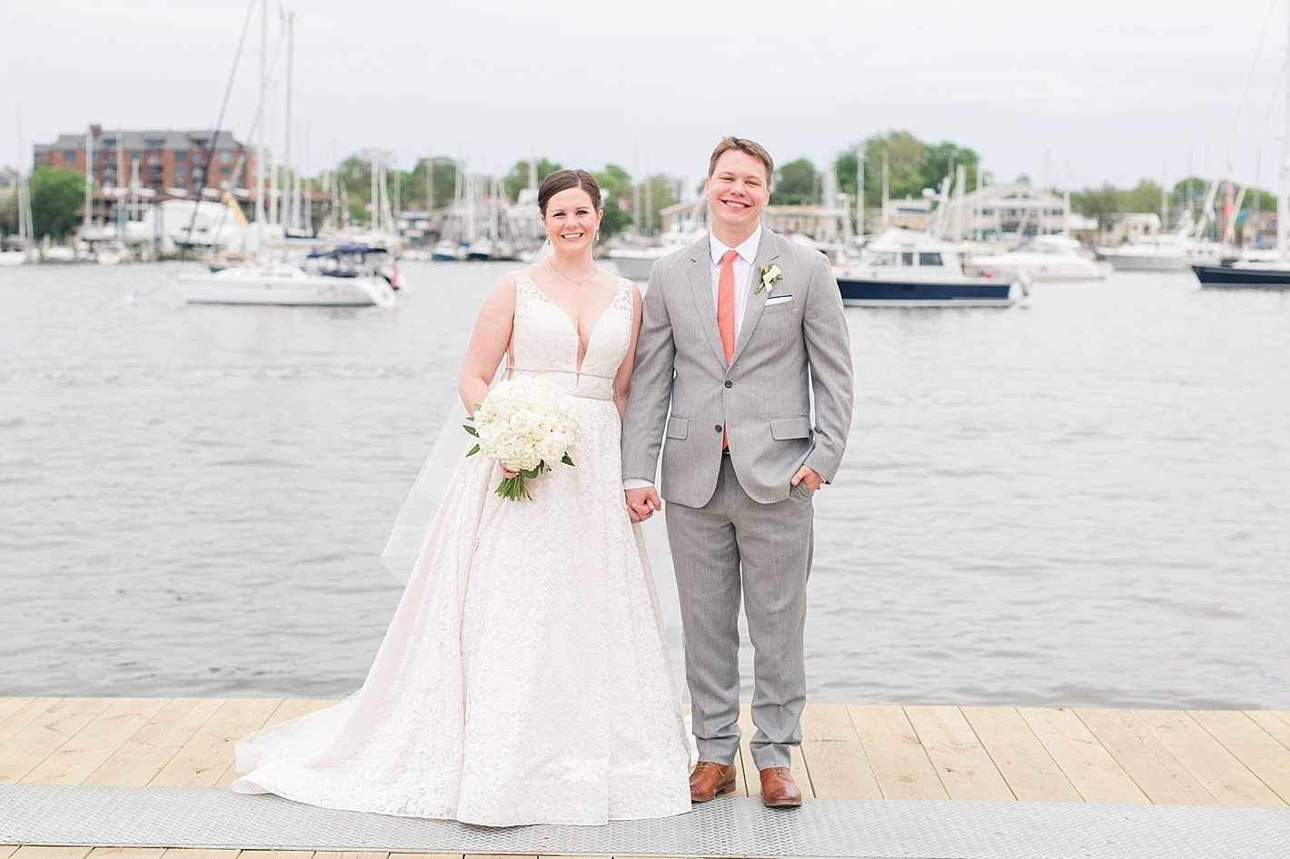bride and groom holding hands Annapolis MD docks