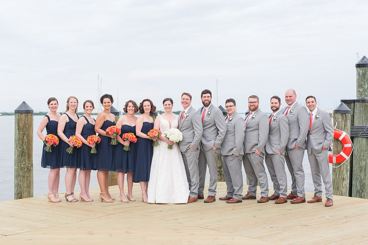Bridal party photo navy and peach downtown Annapolis docks