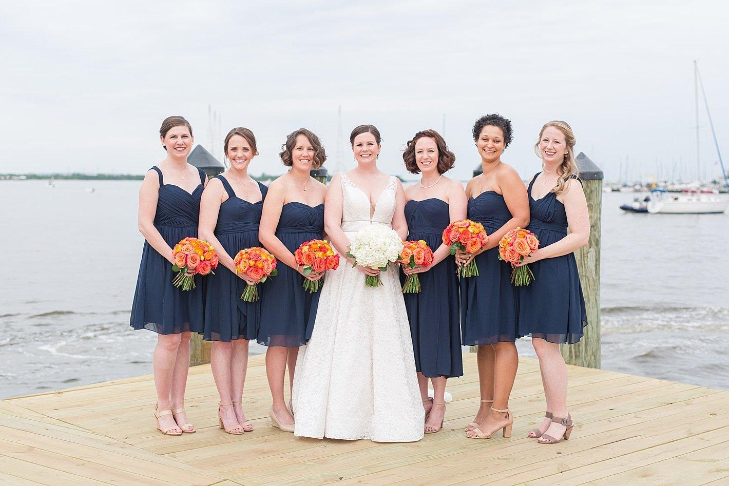 Navy bridesmaid dresses Jenny Yoo dresses peach bouquets