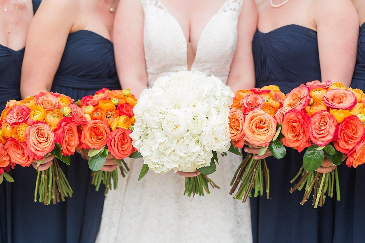 Navy bridesmaid dresses Jenny Yoo dresses peach bouquets roses peonies