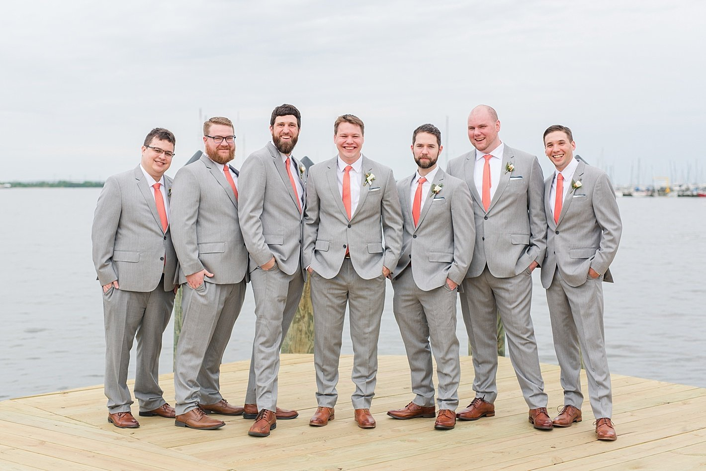 gray suits peach ties groomsmen Annapolis docks