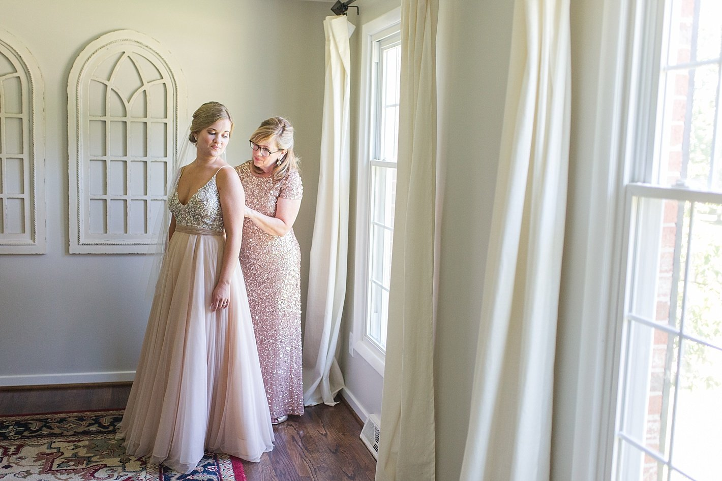 mother of the bride helping get ready, BHLDN wedding gown, gold mother of the bride dress