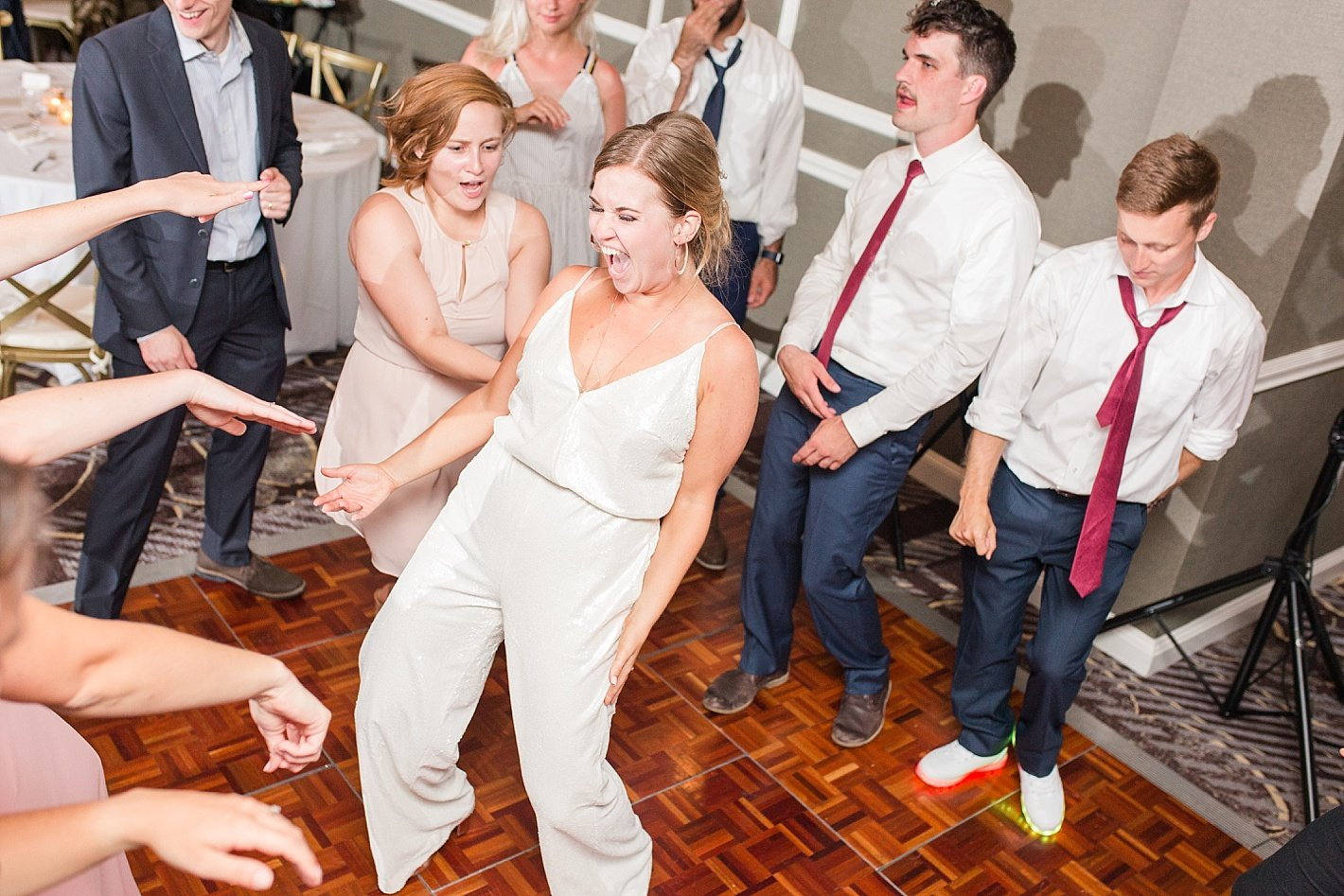 Eagles Nest Country Club wedding reception, Arpasi Photography dancing reception photos, bride white jumpsuit