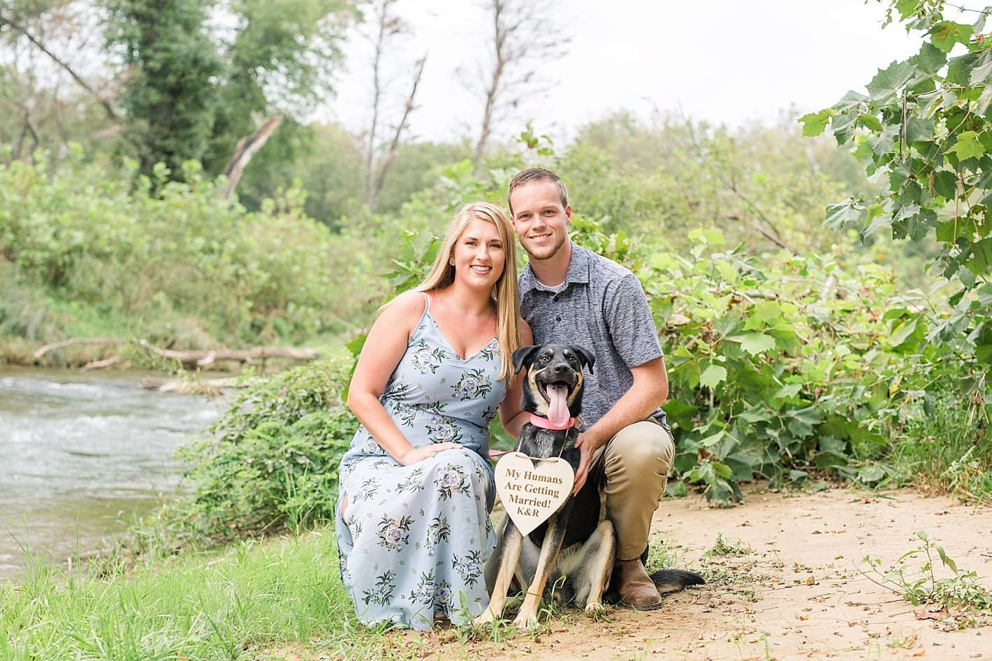 NCR trail engagement photography, Baltimore engagement photographer, coordinating blue outfits for engagement photos, my humans are getting married sign for dog