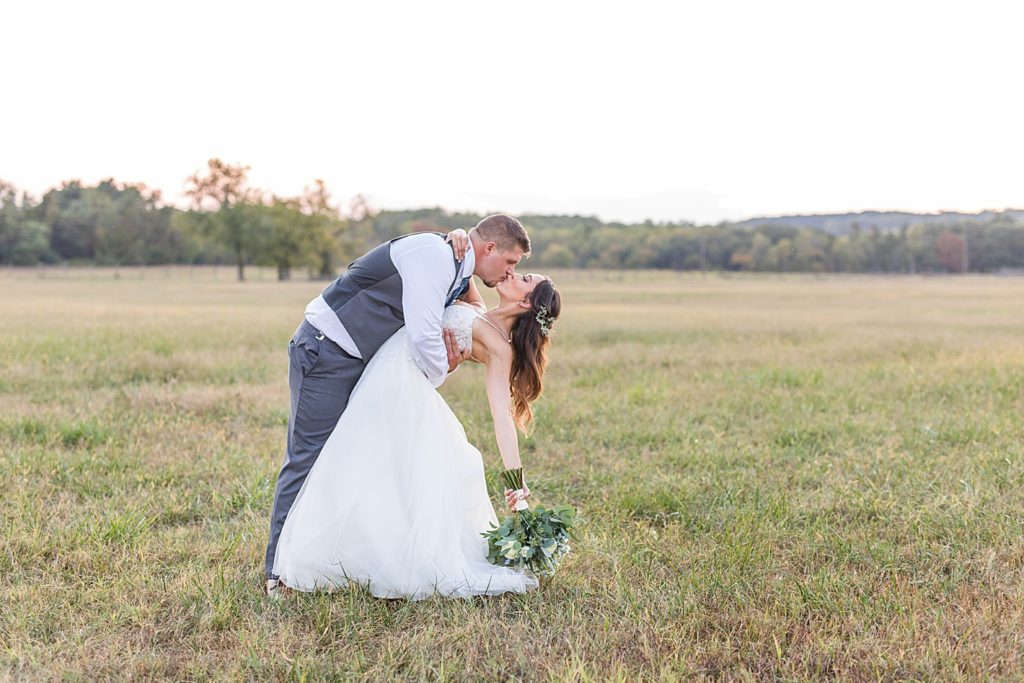 Newlyweds in Field at Sunset at Bohemia Overlook