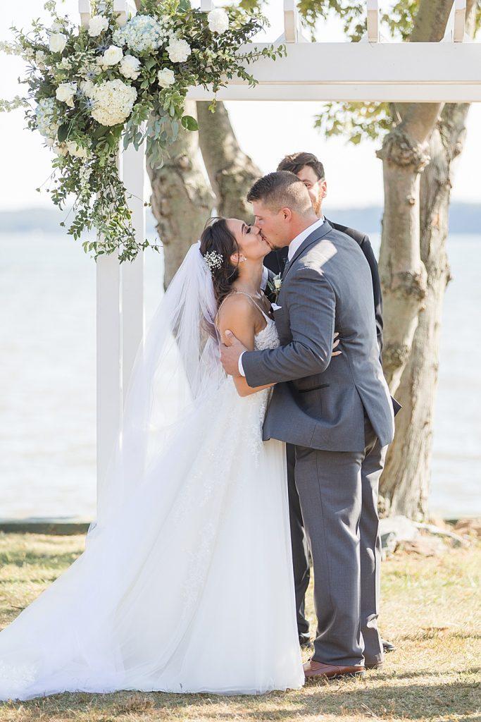 Newlyweds Kiss at Bohemia Overlook Wedding Ceremony